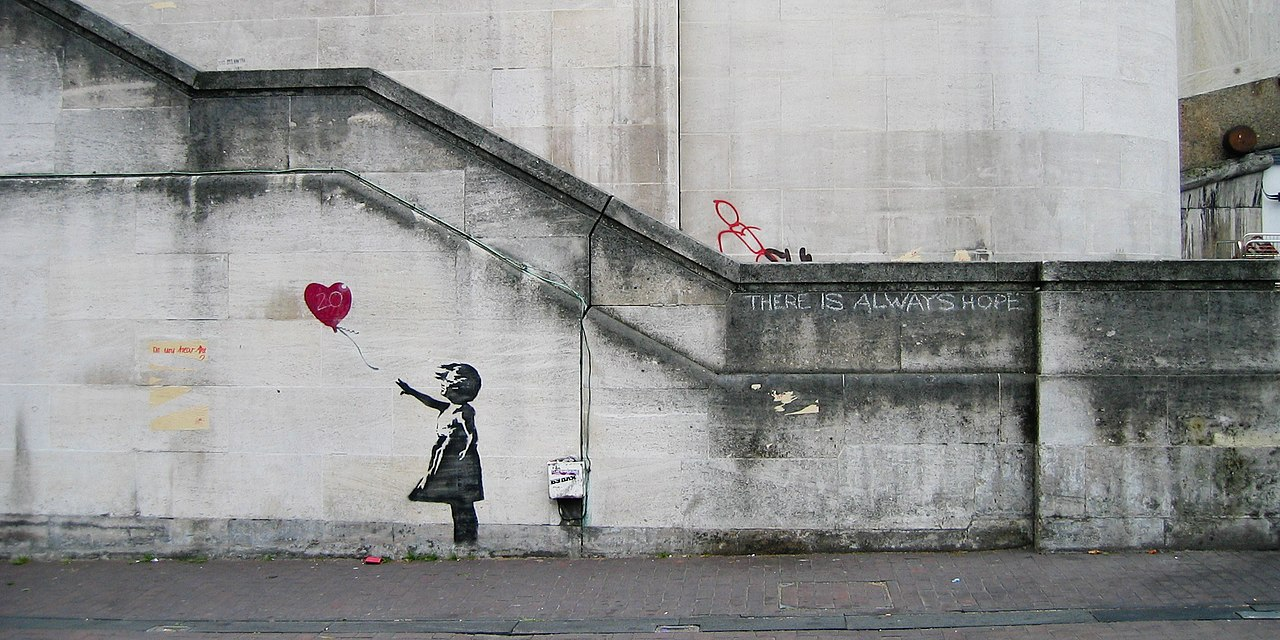 Banksy, Girl and Heart Balloon, by Dominic Robinson - CC BY-SA 2.0, https://commons.wikimedia.org/w/index.php?curid=73570221